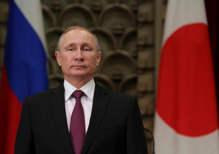 Russian President Vladimir Putin attends a signing ceremony following a meeting with Japanese Prime Minister Shinzo Abe in Tokyo, Japan, December 16, 2016. Sputnik/Michael Klimentyev/Kremlin/via REUTERS