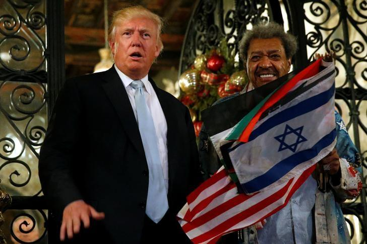 U.S. President-elect Donald Trump (L) and boxing promoter Don King speak to reporters outside the Mar-a-lago Club in Palm Beach, Florida, U.S. December 28, 2016. REUTERS/Jonathan Ernst