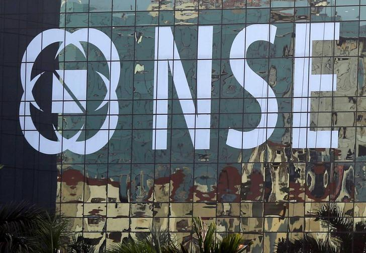 Buildings are reflected on the glass windows of the NSE (National Stock Exchange) building in Mumbai, India, December 27, 2016. REUTERS/Shailesh Andrade
