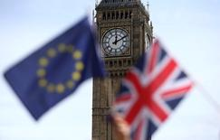 Participants hold a British Union flag and an EU flag during a pro-EU referendum event at Parliament Square in London, Britain June 19, 2016. REUTERS/Neil Hall/File Photo