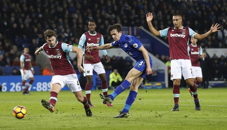 Leicester City v West Ham United - Premier League - King Power Stadium - 31/12/16 Leicester City's Ben Chilwell shoots at goal as West Ham United's Havard Nordtveit looks on Reuters / Darren Staples Livepic