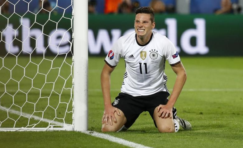 Germany's Julian Draxler reacts after missing a chance to score  REUTERS/Kai Pfaffenbach