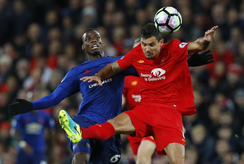 Liverpool's Dejan Lovren in action with Manchester United's Paul Pogba.  Reuters / Phil Noble Livepic