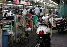 La actividad del sector manufacturero de Japón se expandió a su mayor ritmo en un año en diciembre gracias a un repunte de las órdenes, mostró el miércoles un sondeo privado, en una alentadora señal de que la economía podría estar recuperando fuerza. En la imagen, una fábrica de Honda en Ozu, Japón, el 13 de septiembre de 2016. REUTERS/Naomi Tajitsu