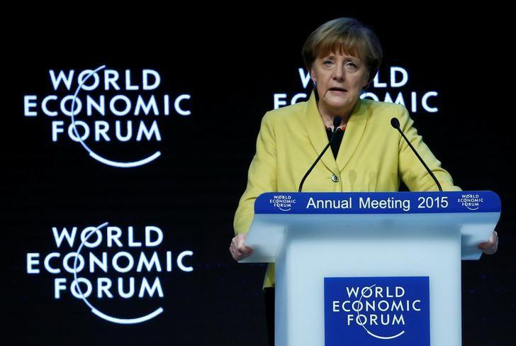 FILE PHOTO - German Chancellor Angela Merkel makes a speech during the session ''Global Responsibilities in a Digital Age'' in the Swiss mountain resort of Davos January 22, 2015. REUTERS/Ruben Sprich/File Photo - RTX2X8IY