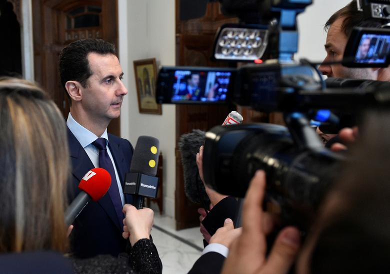 Syria's President Bashar al-Assad speaks to French journalists in Damascus, Syria, in this handout picture provided by SANA on January 9, 2017. SANA/Handout via REUTERS