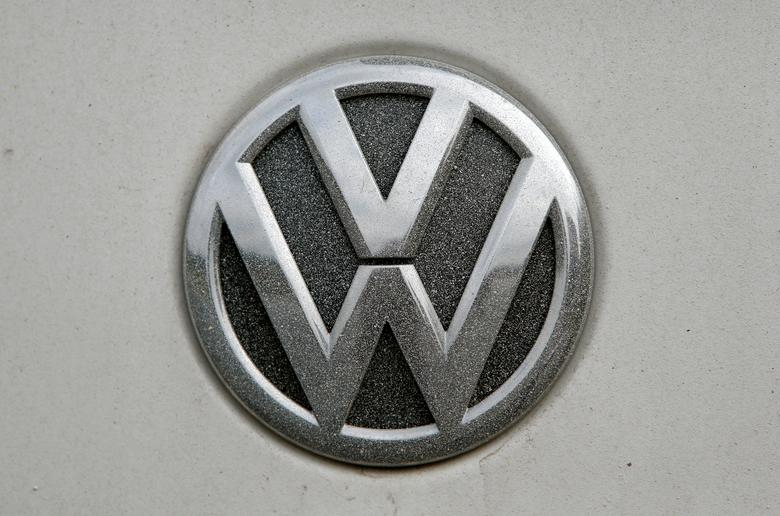FILE PHOTO:  A Volkswagen (VW) logo covered with dust is seen in Grafenwoehr, Germany, October 26, 2016.   REUTERS/Michaela Rehle/File Photo