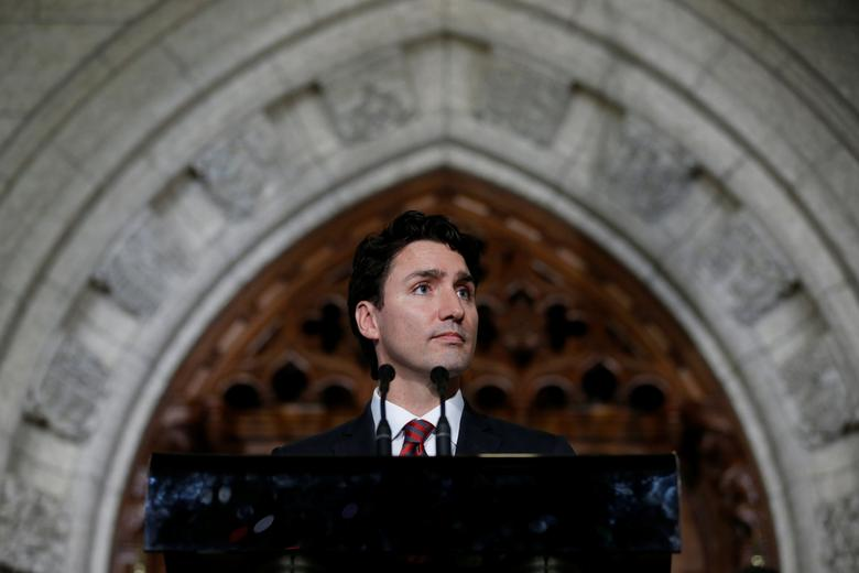 Canada's Prime Minister Justin Trudeau takes part in a news conference on Parliament Hill in Ottawa, Ontario, Canada, December 15, 2016. REUTERS/Chris Wattie