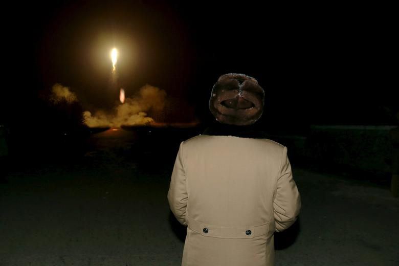 North Korean leader Kim Jong Un watches the ballistic rocket launch drill of the Strategic Force of the Korean People's Army (KPA) at an unknown location, in this undated photo released by North Korea's Korean Central News Agency (KCNA) in Pyongyang on March 11, 2016.     REUTERS/KCNA