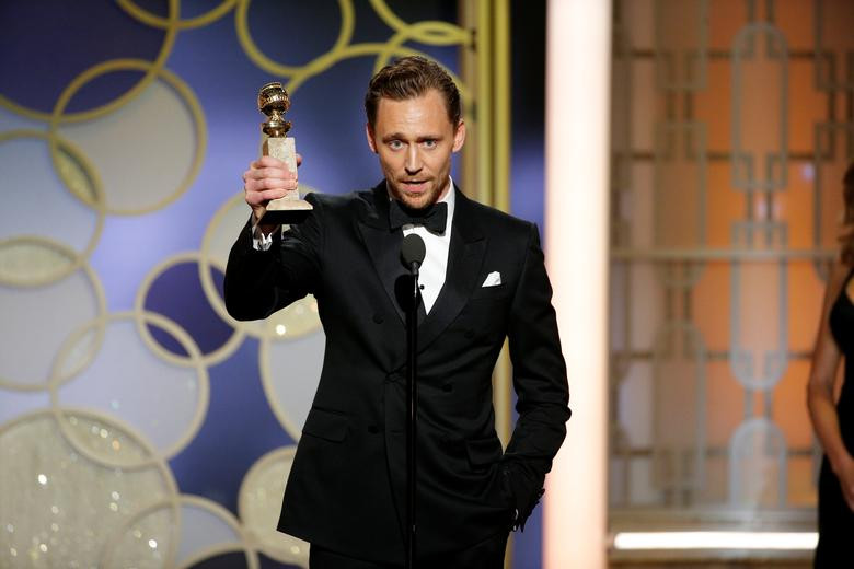 Actor Tom Hiddleston holds the award for Best Actor - Limited Series or Motion Picture for TV for ''The Night Manager'' during the 74th Annual Golden Globe Awards show in Beverly Hills, California, U.S., January 8, 2017. Paul Drinkwater/Courtesy of NBC/Handout via REUTERS