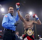 Apr 24, 2015; Chicago, IL, USA; Daniel Jacobs celebrates after winning against Caleb Truax during the Premier Boxing Championships at UIC Pavilion. Mandatory Credit: Kamil Krzaczynski-USA TODAY Sports