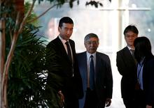 Bank of Japan (BOJ) Governor Haruhiko Kuroda (2nd L) walks after meeting with Japan's Prime Minister Shinzo Abe at Abe's official residence in Tokyo, Japan January 11, 2017. REUTERS/Toru Hanai