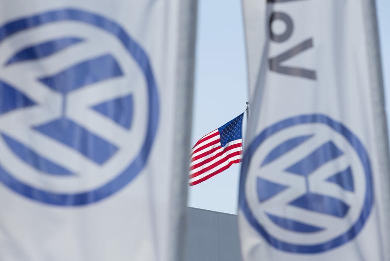 An American flag flies next to a Volkswagen car dealership in San Diego, California, U.S. September 23, 2015.   REUTERS/Mike Blake/File Photo