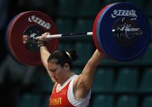 Silver medal winner Cao Lei of China competes in the women's 75 kg weightlifing competition at the 16th Asian Games in Guangzhou, Guangdong province November 18, 2010.   REUTERS/Mick Tsikas