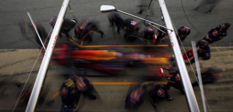 Formula One - Barcelona tests - Barcelona-Catalunya racetrack, Montmelo, Barcelona, Spain - 2/3/16. Red Bull F1 driver Daniel Ricciardo makes a pit-stop. REUTERS/Albert Gea