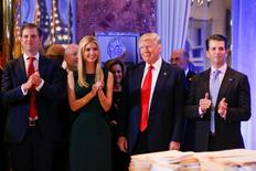U.S. President-elect Donald Trump (C) smiles as he is applauded by his son Eric Trump (L) daughter Ivanka and son Donald Trump Jr. (R) ahead of a press conference in Trump Tower, Manhattan, New York, U.S., January 11, 2017. REUTERS/Shannon Stapleton