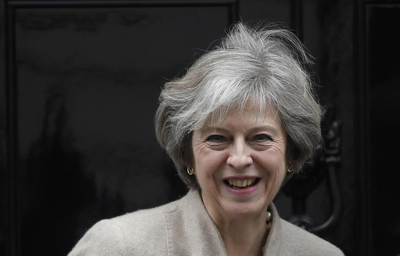 Britain's Prime Minister Theresa May waits to greet her New Zealand counterpart Bill English at Number 10 Downing Street in London, Britain, January 13, 2017. REUTERS/Toby Melville