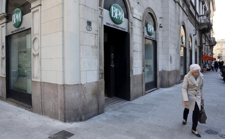 A woman walks past Banca Popolare di Milano ( BPM) downtown Milan, Italy, February 11, 2016. REUTERS/Stefano Rellandini/File Photo