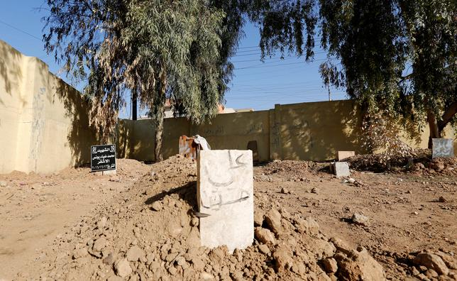 A cemetery for people who were killed in the clashes is seen at a grave in a schoolyard east of Mosul, Iraq, January 11, 2017. Picture taken 11, 2017.  REUTERS/Ahmed Saad