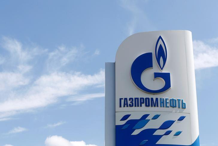 A board with the logo of Gazprom Neft oil company is on display at a fuel station in Moscow, Russia, May 30, 2016. REUTERS/Maxim Zmeyev/Files