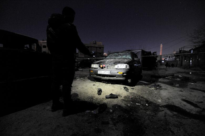 A man inspects damage after an explosion in Kafr Sousa neighborhood of Damascus, Syria January 12, 2017. REUTERS/Omar Sanadiki