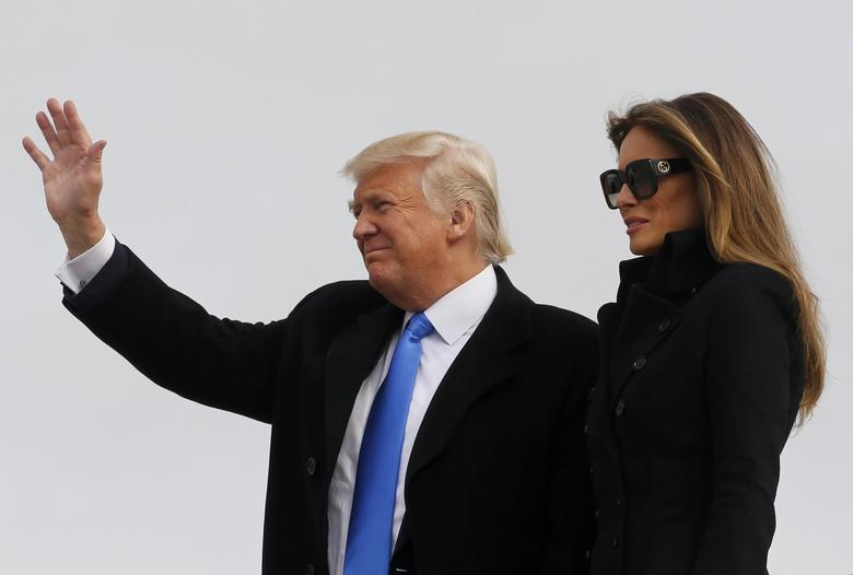 U.S. President-elect Donald Trump and his wife Melania arrive at Joint Base Andrews outside Washington, U.S. January 19, 2017, one day before his inauguration as the nation's 45th president. REUTERS/Jonathan Ernst