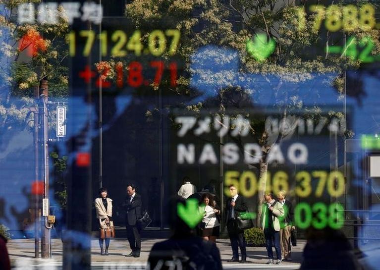 Asian stocks slip, dollar flat as caution reigns before Trump inauguration