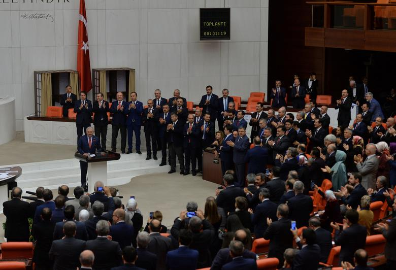 Turkey's Prime Minister and the leader of ruling AK Party Binali Yildirim makes a speech following the approval of a constitutional reform bill at the Turkish parliament in Ankara, Turkey, January 21, 2017. REUTERS/Stringer