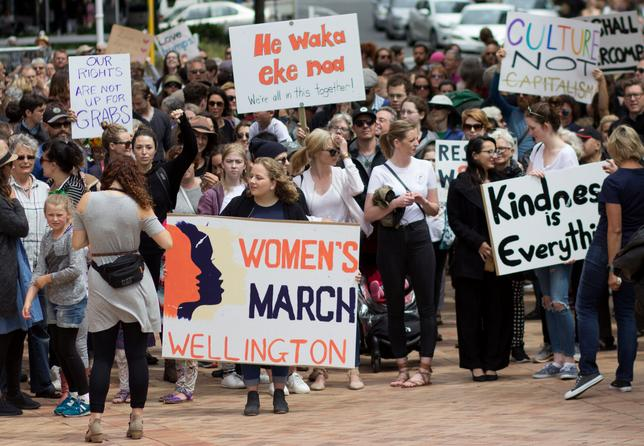 Participants of a rally regarding women's rights hold placards as they march in Wellington, New Zealand, January 21, 2017 the day after Donald Trump's inauguration as President of the United States.    Joshua Gimblett/Handout via REUTERS