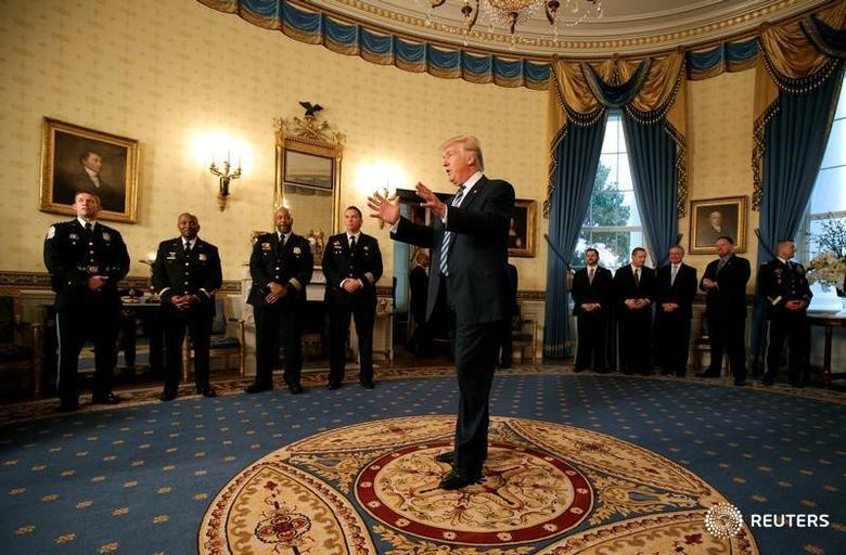 U.S. President Donald Trump speaks during the Inaugural Law Enforcement Officers and First Responders Reception in the Blue Room of the White House in Washington, U.S., January 22, 2017.      REUTERS/Joshua Roberts - RTSWUZ4