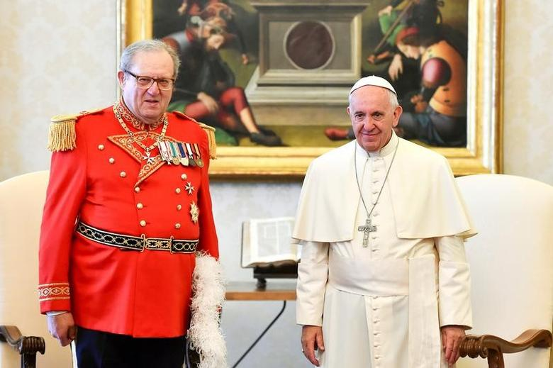 FILE PHOTO: Pope Francis (R) meets Robert Matthew Festing, Prince and Grand Master of the Sovereign Order of Malta during a private audience at the Vatican June 23, 2016.  REUTERS/Gabriel Bouys/Pool/File Photo
