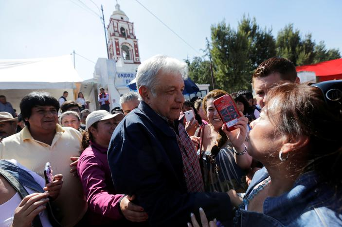 Andres Manuel Lopez Obrador (C), leader of the National Regeneration Movement (MORENA) party, greets supporters after giving a speech in Tlapanoloya, Mexico, January 25, 2017. REUTERS/Henry Romero