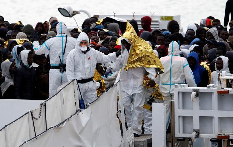 Migrants start to disembark from Italian Coast Guard patrol vessel Diciotti in the Sicilian harbour of Catania, Italy, January 28, 2017. REUTERS/Antonio Parrinello