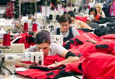 FILE PHOTO -  Workers piece together outerwear on the manufacturing floor of Canada Goose's facility in Toronto January 17, 2012.      REUTERS/Fred Thornhill/File Photo