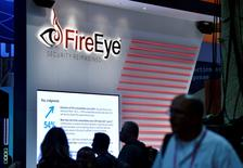 Attendees walk by the FireEye booth during the 2016 Black Hat cyber-security conference in Las Vegas, Nevada, U.S. August 3, 2016.  REUTERS/David Becker