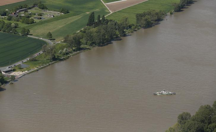File Photo: An aerial picture shows a ferry over Europe's most frequented waterway the river Rhine in Mondorf, a suburb of the North Rhine-Westphalian city of Bonn, Germany May 6, 2015.  REUTERS/Wolfgang Rattay