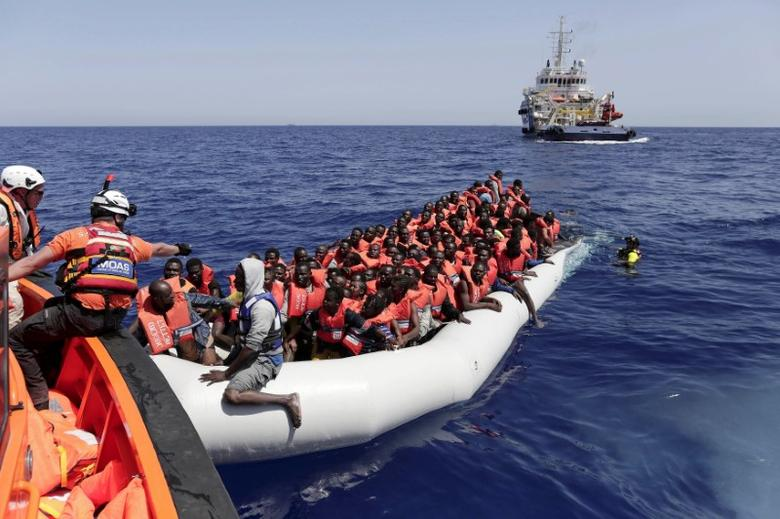 Migrants are rescued during a MOAS operation off the coast of Libya August 18, 2016 in this handout picture courtesy of the Italian Red Cross released on August 19, 2016. Picture taken August 18, 2016. Yara Nardi/Italian Red Cross/Handout via REUTERS