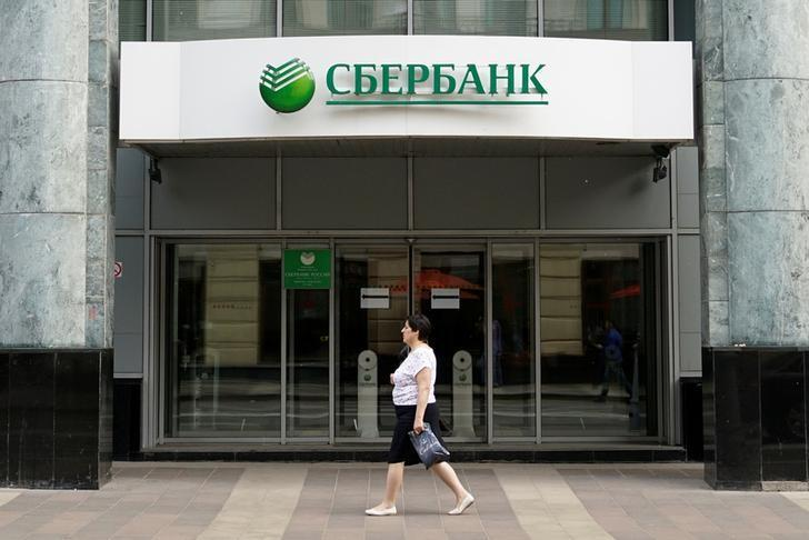 A woman walks past a branch of Sberbank in Moscow, Russia, June 3, 2016. REUTERS/Maxim Zmeyev/Files