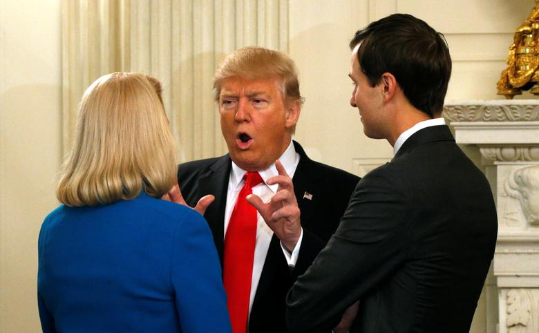 U.S. President Donald Trump talks with IBM CEO Ginni Rometty (L) and his senior advisor Jared Kushner (R) while hosting a strategy and policy forum with chief executives of major U.S. companies at the White House in Washington February 3, 2017.  REUTERS/Kevin Lamarque