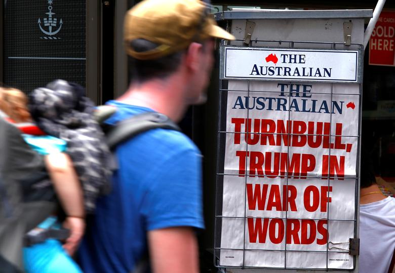 A pedestrian looks at a newspaper headline regarding U.S. President Donald Trump and Australian Prime Minister Malcolm Turnbull in central Sydney, Australia, February 3, 2017.     REUTERS/David Gray