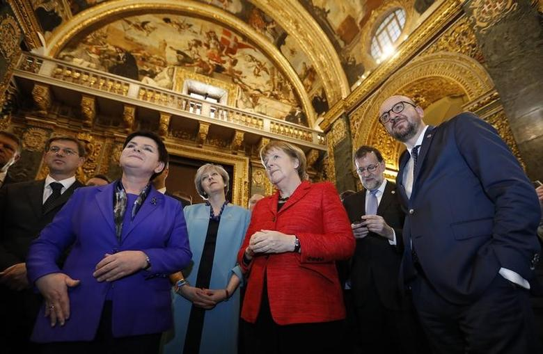 L-R, Slovenian Prime Minister Miro Cerar, Polish Prime Minister Beata Szydlo, British Prime Minister Theresa May, German Chancellor Angela Merkel, Spanish Prime Minister Mariano Rajoy Brey and Belgian Prime Minister Charles Michel, visit Saint John's Co-Cathedral during a break in the European Union leaders summit in Valletta, Malta, February 3, 2017.    REUTERS/Yves Herman