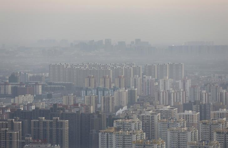 Beijing's skyline is seen from a high-rise building as China warned residents across a large part of northern China to prepare for a wave of choking smog arriving over the weekend, in Beijing, China, December 18, 2015. REUTERS/Kim Kyung-Hoon