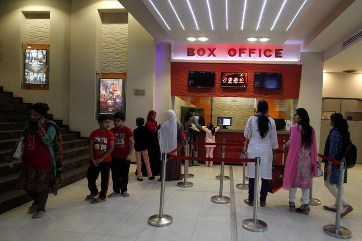 People stand outside a ticket counter at Atrium Mall & Cinemas in Karachi, Pakistan, December 19, 2016. REUTERS/Akhtar Soomro/Files