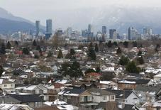 Rooftops of houses in the Kitsilano neighbourhood and the downtown core are seen in the hot real estate market of Vancouver, British Columbia, Canada January 6, 2017.  REUTERS/Chris Helgren