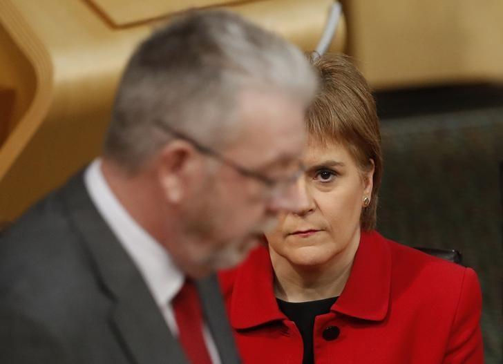 Scotland's First Minister Nicola Sturgeon listens as Michael Russell (MSP) Minister for UK Negotiations on Scotland's Place in Europe speaks during the Scottish Parliament debate on the triggering of article 50 in the main chamber of the Scottish Parliament in Edinburgh, Scotland, Britain, February 7, 2017. REUTERS/Russell Cheyne