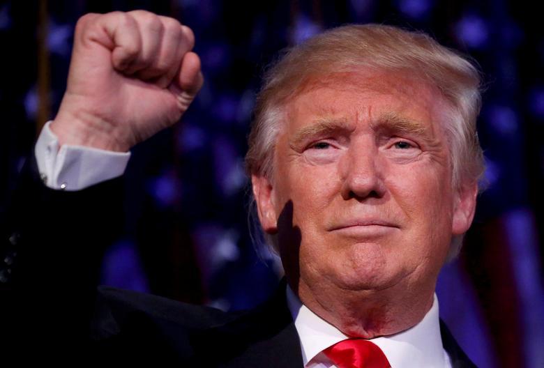 FILE PHOTO:  U.S. President-elect Donald Trump speaks at his election night rally in Manhattan, New York, U.S., November 9, 2016.     REUTERS/Carlo Allegri/File Photo