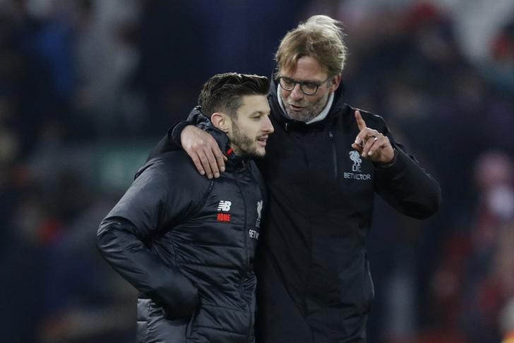 Britain Football Soccer - Liverpool v Stoke City - Premier League - Anfield - 27/12/16 Liverpool manager Juergen Klopp celebrates with Adam Lallana at the end of the match  Reuters / Darren Staples Livepic