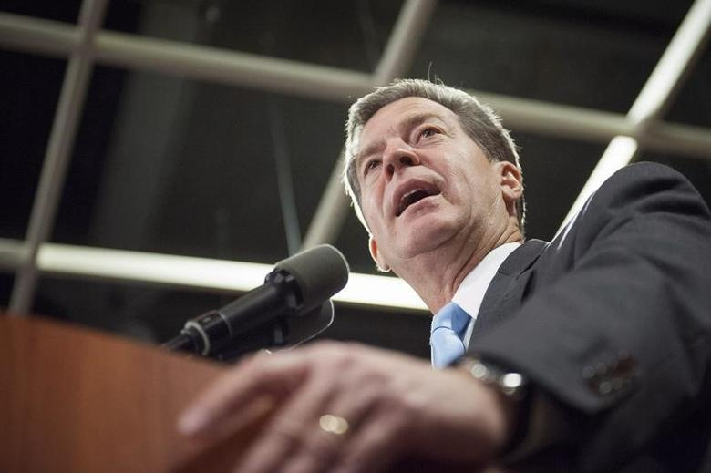 Republican Kansas Governor Sam Brownback speaks to supporters after winning re-election in the U.S. midterm elections in Topeka, Kansas, November 4, 2014. REUTERS/Mark Kauzlarich