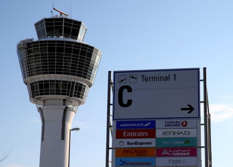 Control tower and signage at Munich's international airport, Germany January 17, 2017. REUTERS/Michael Dalder