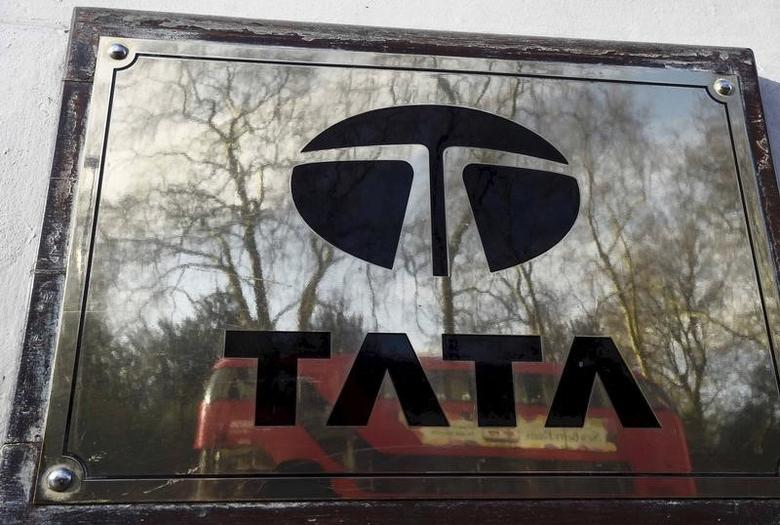 A bus is reflected in a Tata sign outside their offices in London, Britain in this March 30, 2016 file photo.   REUTERS/Toby Melville/Files